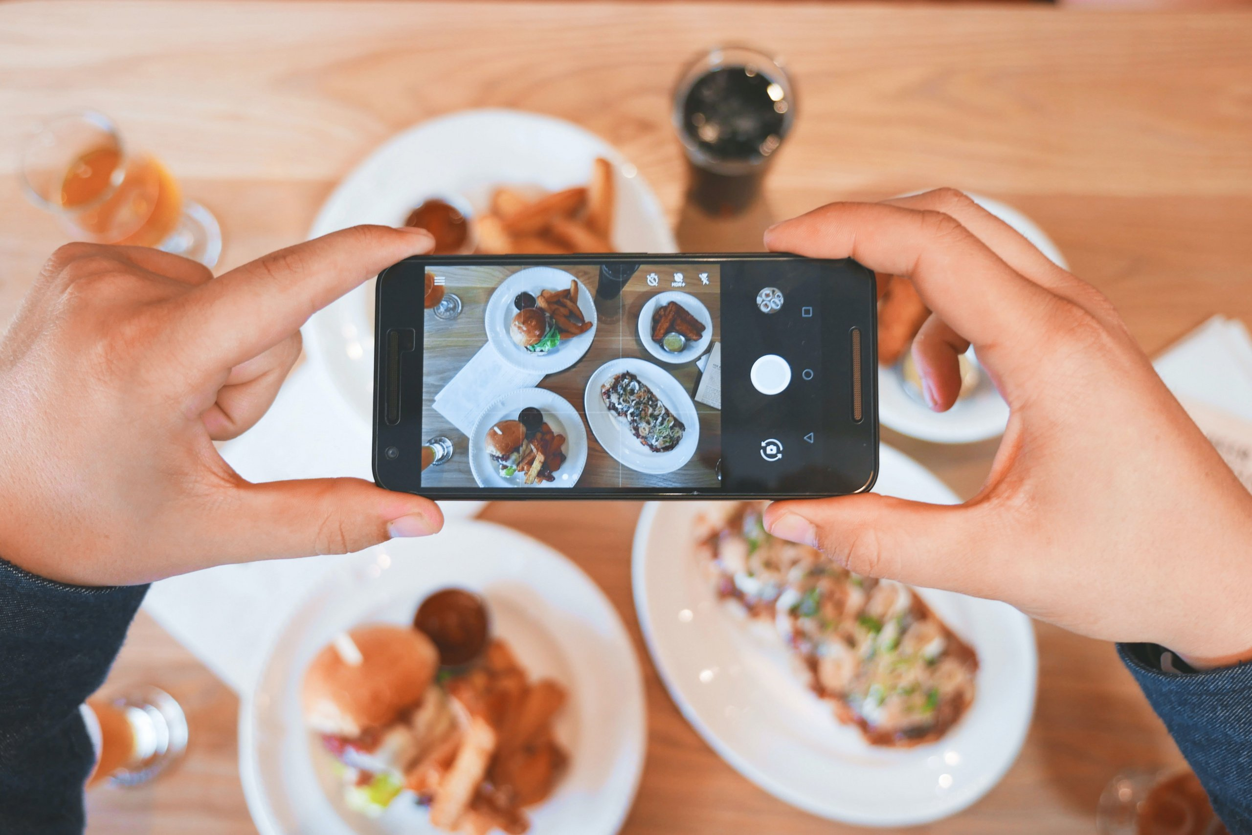 person taking a picture of their food